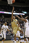 Georgia Tech Yellow Jackets guard Glen Rice Jr. (41) lays one in off balance as Wake Forest Demon Deacons guard C.J. Harris (11) and Wake Forest Demon Deacons guard Tony Chennault (1) can only watch. Georgia Tech wins 80-54.