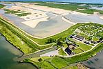 Nederland, Zuid-Holland, Tiengemeten 10-06-2015; middendeel van het eiland Tiengemeten ter hoogte van de haven en met moeras in wording. <br /> Oorspronkelijk gebruikt voor de akkerbouw maar inmiddels 'teruggegeven aan de natuur', de dijken zijn deels doorgestoken, de laatste boer is in 2006 vertrokken. De 'nieuwe natuur' vormt onderdeel van de Ecologische Hoofdstructuur. <br /> The island Tiengemeten in the Haringvliet, was originally used for agriculture but has now &quot;been given back to nature&quot;. Large parts have been flooded and the isle is part of the National Ecological Network. The last farmer left in 2006. Current use, among other, care farms and camping.<br /> luchtfoto (toeslag op standard tarieven);<br /> aerial photo (additional fee required);<br /> copyright foto/photo Siebe Swart
