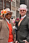 Two men wear colorful top hats to the Easter Day Parade in New York City on Fifth Avenue