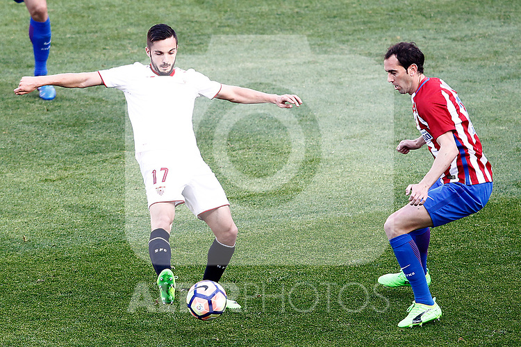 Atletico de Madrid's Diego Godin (r) and Sevilla FC's Pablo Sarabia during La Liga match. March 19,2017. (ALTERPHOTOS/Acero)