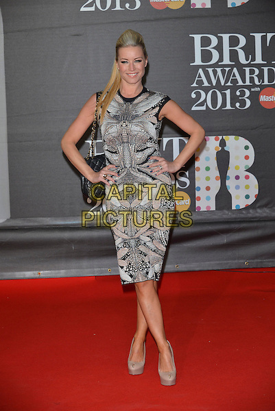 Denise Van Outen.The Brit Awards 2013 arrivals at the O2, Greenwich, London, England 20th February 2013.The Brits full length print dress black white hands on hips sleeveless cream beige platform shoes brits arrivals chanel bag .CAP/PL.©Phil Loftus/Capital Pictures.
