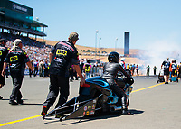 Jul 27, 2019; Sonoma, CA, USA; Crew members with NHRA pro stock motorcycle rider Jianna Salinas during qualifying for the Sonoma Nationals at Sonoma Raceway. Mandatory Credit: Mark J. Rebilas-USA TODAY Sports