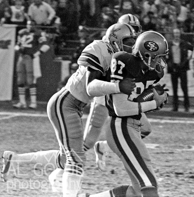 San Francisco 49ers vs.Dallas Cowboys at Candlestick Park Sunday, January 10. 1982..49ers beat Cowboys 28-27 for Conference Championship..Dallas Cowboys Defensive Back Everson Walls (24) hangs on to San Francisco Wide Receiver Dwight Clark (87) after he catches pass...Photo By Al Golub/Golub Photography.
