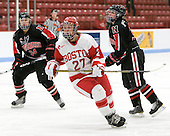 Kristi Kehoe (NU - 34), Tara Watchorn (BU - 27), Katie MacSorley (NU - 3) - The Boston University Terriers defeated the visiting Northeastern University Huskies 3-0 on Tuesday, December 7, 2010, at Walter Brown Arena in Boston, Massachusetts.