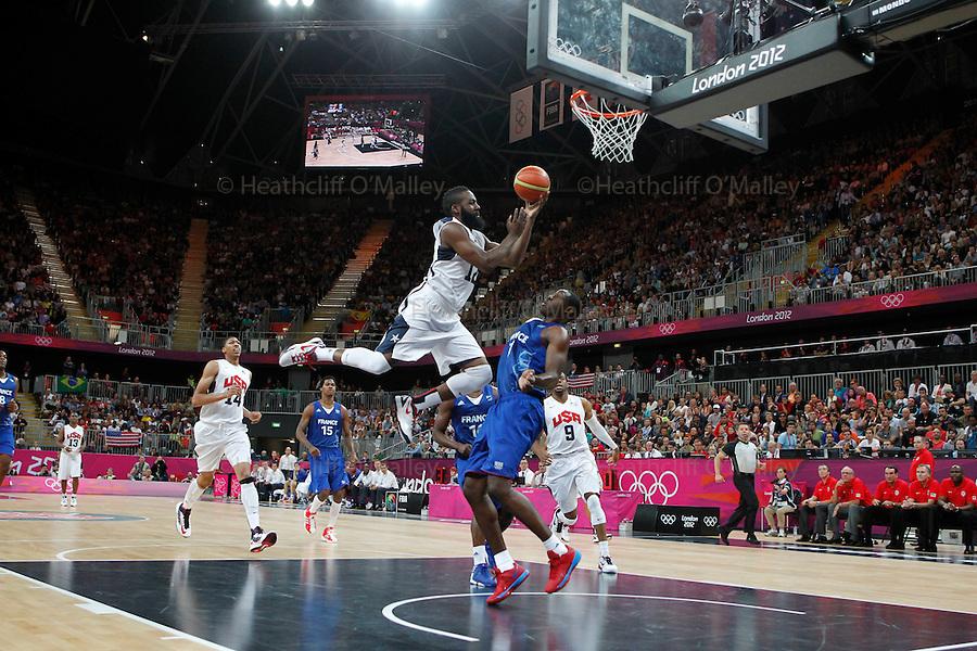 Mcc0041438 . Daily Telegraph..DT Sport.2012 Olympics..Nando de Colo attacks for USA AS Florent Pietrus defends..USA vs France basketball..29 July 2012.