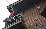 Maddie Grabill prepares to jump off the zip line, while course worker, Tom Maher holds the line steady. The Zip Line facility Sibs Weekend event was held at The Ridges on Feb. 3rd, 2018.
