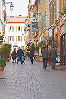 A market street in the old town, people walking on the street Sanary Var Cote d'Azur France