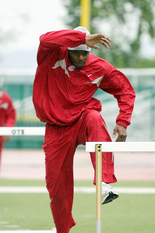 Jeshua Anderson, Washington State sophomore, warms up during the Cougars dual track and field meet with arch-rival Washington at Husky Stadium in Seattle, Washington, on May 2, 2009.