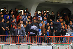 Fans watch as Palestinian Etihad al-Shujaiya players (green T-shirt) and Shabab Khanyounis players (whiteT-shirt) compete during a local competition, at Palestine Stadium, in Gaza City on January 20, 2019. The match ende 2-1 to Shabab Khanyounis club. Photo by Mahmoud Ajjour