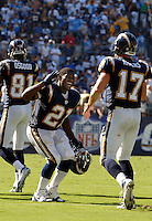 Sept. 17, 2006; San Diego, CA, USA; San Diego Chargers running back (21) LaDainian Tomlinson celebrates a touchdown with quarterback (17) Phillip Rivers against the Tennessee Titans defender at Qualcomm Stadium in San Diego, CA. Mandatory Credit: Mark J. Rebilas