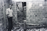 Kosovar Albanian surveys what's left of his home in the village of Strellc. Serbian forces burned many homes in the area along the border with Albania which saw heavy fighting during the war.