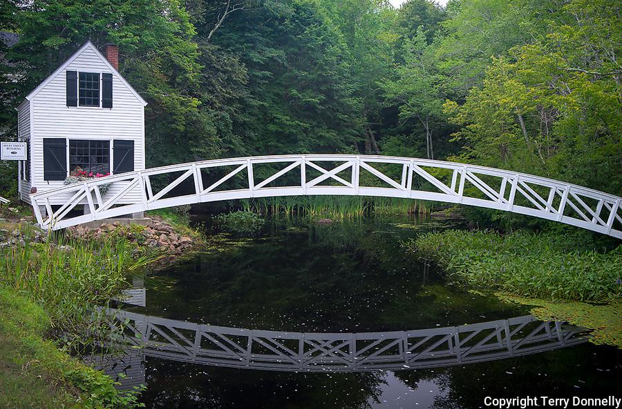 Somesville, Mount Desert Island, Maine:<br /> Selectmen's building (1870) and Thaddeus Somes Memorial bridge reflecting in summer pond.