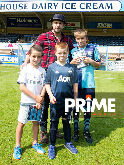 Shayne Ward with mascots pre match during the Sellebrity Soccer match for Wycombe Sports & Education Trust at Wycombe Wanderers, Adams Park, High Wycombe, England on 28 May 2018. Photo by Andy Rowland.