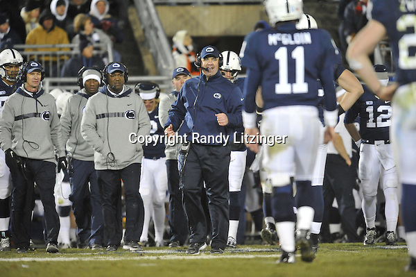 24 November 2012:  Penn State coach Bill O'Brien talks to Matt McGloin from the sideline. The Penn State Nittany Lions defeated the Wisconsin Badgers 24-21 in OT overtime at Beaver Stadium in State College, PA.