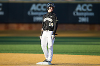 Conor Keniry (14) of the Wake Forest Demon Deacons stands on second base after hitting a double against the Georgetown Hoyas at Wake Forest Baseball Park on February 16, 2014 in Winston-Salem, North Carolina.  The Demon Deacons defeated the Hoyas 3-2.  (Brian Westerholt/Four Seam Images)