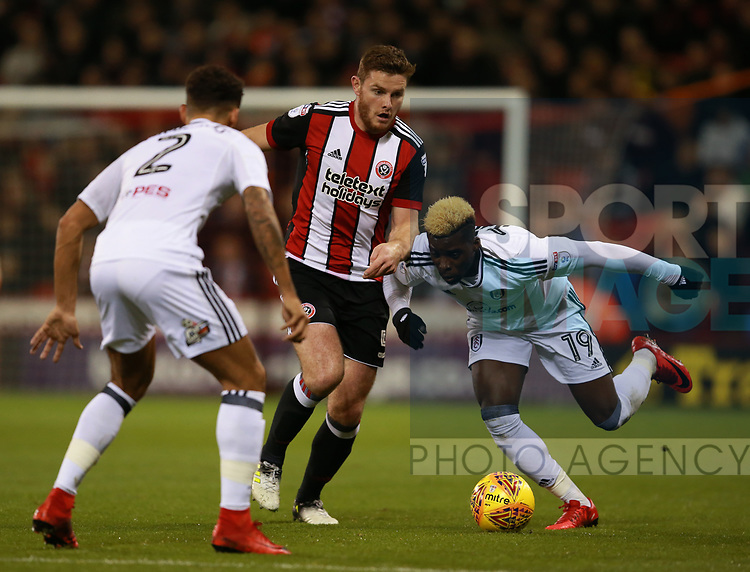 Jack O'Connell of Sheffield Utd tackles Sheyi Ojo of Fulham during the Championship match at Bramall Lane Stadium, Sheffield. Picture date 21st November 2017. Picture credit should read: Simon Bellis/Sportimage