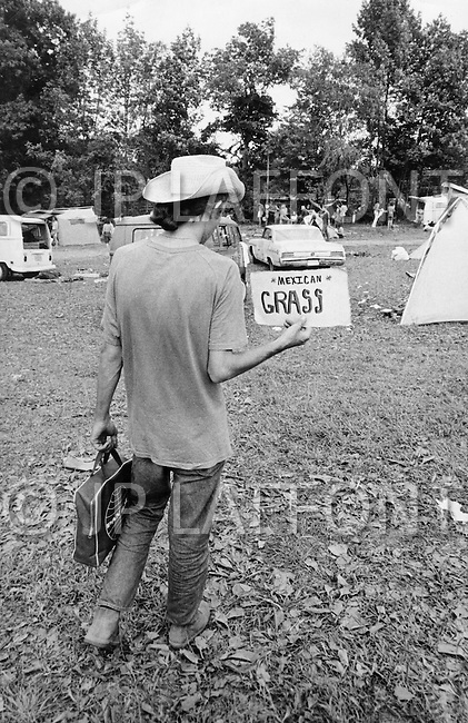 Middlefield, CT. August 1st and 2nd 1970.<br /> Powder Ridge Festival in Middlefield. Man selling grass.<br /> The Powder Ridge Rock Festival was scheduled to be held July 31, August 1 and August 2, 1970 at Powder Ridge Ski Area in Middlefield, Connecticut. A legal injunction forced the event to be canceled, keeping the musicians away; but a crowd of 30,000 attendees arrived anyway, to find no food, no entertainment, no adequate plumbing, and at least seventy drug dealers.