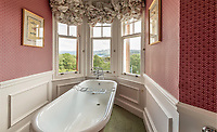 BNPS.co.uk (01202 558833)<br /> Pic: BellIngram/BNPS<br /> <br /> Bath-room with a view.<br /> <br /> A magnificient Scottish castle which comes with its own two islands is on the market for £3.75million.<br /> <br /> Glenborrodale Castle is situated on the southern shore of the picturesque Ardnamurchan Peninsula in the remote Highlands. <br /> <br /> The baronial mansion dates from 1902 and is built from distinctive red Dumfriesshire sandstone.<br /> <br /> It boasts 133 acres of land taking in the idyllic uninhabited isles of Risga and Eileam an Feidh.<br /> <br /> The larger of the two, Risga, spans 30 acres and is in the centre of Loch Sunart, 800 yards from the north shore