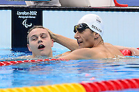 PICTURE BY ALEX BROADWAY /SWPIX.COM - 2012 London Paralympic Games - Day Seven - Swimming, Aquatic Centre, Olympic Park, London, England - 05/09/12 - Oliver Hynd of Great Britain is congratulated by Maurice Deelen of The Netherlands after the Men's 200m Individual Medley Final.