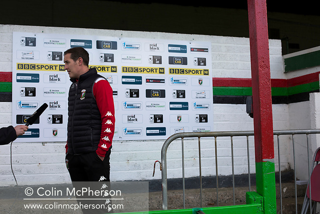 Home manager Gary Haveron pictured during a television interview on the pitch at The Oval, Belfast after Glentoran hosted city-rivals Cliftonville in an NIFL Premiership match. Glentoran, formed in 1892, have been based at The Oval since their formation and are historically one of Northern Ireland's 'big two' football clubs. They had an unprecendentally bad start to the 2016-17 league campaign, but came from behind to win this fixture 2-1, watched by a crowd of 1872.