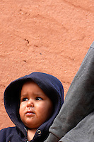 A child is pictured on December 12, 2003, in the Saharawi refugee camps of Aljer. Saharawi people have been living at the refugee camps of the Algerian desert named Hamada, or desert of the deserts, for more than 30 years now. Saharawi people have suffered the consecuences of European colonialism and the war against occupation by Moroccan forces. Polisario and Moroccan Army are in conflict since 1975 when Hassan II, Moroccan King in 1975, sent more than 250.000 civilians and soldiers to colonize the Western Sahara when Spain left the country. Since 1991 they are in a peace process without any outcome so far. (Ander Gillenea / Bostok Photo)