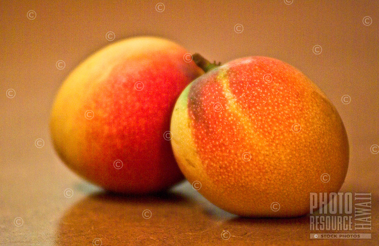 close up of ripe mango's on kitchen counter