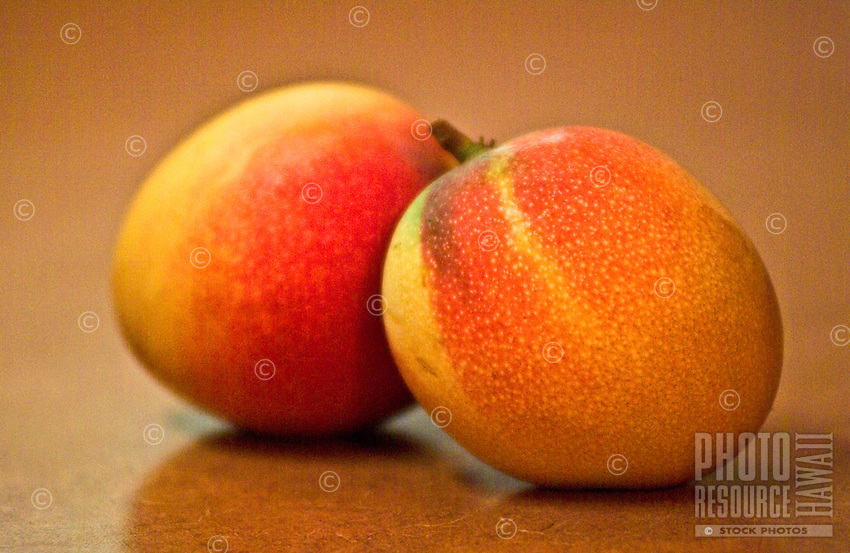 close up of ripe mango's on kitchen counter