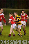 Let there be light. East Kerry's David Nolan shrugs off the attentions of Avondhu's Ronan good in the Duhallow Invitational Cup semi-final played under lights at Knocknagree.   Copyright Kerry's Eye 2008