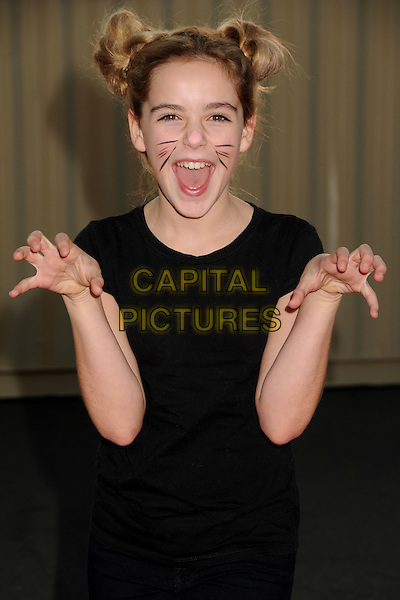 """Kiernan Shipka.18th Annual """"Dream Halloween"""" To Benefit The Children Affected By AIDS Foundation held at Barker Hangar, Santa Monica, California, USA, .29th October 2011 .hallowe'en costume dressed up half length hands gesture black t-shirt facepaint cat mouse bunches buns hair up .CAP/ADM/BP.©Byron Purvis/AdMedia/Capital Pictures."""