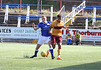 Dan Pybus tackling Jake Carroll in the SPFL Betfred League Cup group match between Queen of the South and Motherwell at Palmerston Park, Dumfries on 13.7.19.