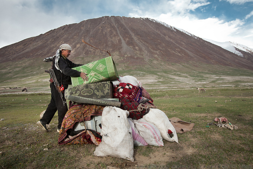 Mujaheed, one of the son of the late Khan, after unloading the yaks, piles up all his worldy goods at the new summer camp. This represents everything he owns...Moving with the Khan (chief) family. The couple of Tella Bu and Daryo Boi family arrive from the Qyzyl Qorum camp to the summer camp of Kara Jylga, on the south side of the wide Little Pamir plateau...Trekking through the high altitude plateau of the Little Pamir mountains (average 4200 meters) , where the Afghan Kyrgyz community live all year, on the borders of China, Tajikistan and Pakistan.