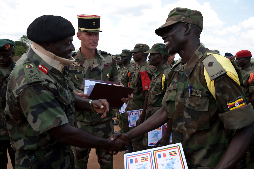 12 february 2010 - SINGO military training camp, Kampala, Uganda - The French Forces based in Djibouti (FFDj) have a military presence mission in the Horn of Africa. This mission is involved most particularly in the implementation of defence co-operation activities with the various countries in the region. Under this framework, the 13th French Foreign Legion half-brigade (13ème DBLE) was appointed to carry out a training course for the benefit of the Uganda Peoples Defence Forces (UPDF) from January 11th till February 15th 2010. During this course, a 1700 men battalion of the UPDF has undergone training in peace keeping operations, while 120 non-commissioned officers (NCO) have trained in commanding the same peace keeping operations. The training is in view of the UPDF deployment in Somalia in May 2010 within the framework of AMISOM. This ceremony was attended by: The Minister of state for Defence: Lt. Gen. Jeje Odong, The Commander of the land forces: Lt. Gen. Katumba Wamala, The Ambassador of France: H.E René Forceville, The Ambassador of Belgium: H. E Marc Gedopt, The Commander of the French Forces based in Djibouti: Air Brigadier General Thierry Caspar-Fille-Lambie, The Defence Attaché of the French embassy: Lt. Col.  Pascal Bayle, The Defence Attaché of the Belgian embassy: Lt. Col. Pol Ameye, The Defence Attaché of the American embassy: Lt. Col. Gregory Joachim, The Defence Attaché of the British High Commission: Lt. Col. Gimm Etherington. Photo credit: Benedicte Desrus