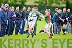 St Micheal's/Foilmore Bernard Kelly and St Brendan's Laurence Bastible in action in the Kerry senior football championship at Blennerville on Saturday.