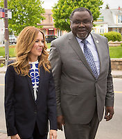 Julie Snyder, fiance of PQ leader Pierre-Karl Peladeau, and PQ MNA Maka Kotto, are seen at a political event for the Chauveau by-election in Wendake, just North of Quebec City, June 3, 2015.