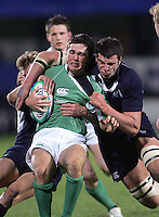Irish centre Eoin O'Malley is tackled by Scottish captain Frazer McKenzie  during the Division A clash in the U19 World Championship at Ravenhill.