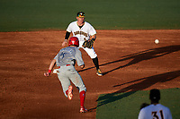 Bradenton Marauders second baseman Mitchell Tolman (5) waits to receive a throw as Derek Campbell (25) runs back to the bag during a game against the Clearwater Threshers on July 24, 2017 at LECOM Park in Bradenton, Florida.  Bradenton defeated Clearwater 6-3  (Mike Janes/Four Seam Images)