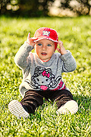 A pretty little girl with red hat having fun