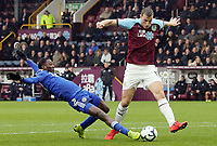 Burnley's Chris Wood is tackled by Leicester City's Wilfred Ndidi<br /> <br /> Photographer Rich Linley/CameraSport<br /> <br /> The Premier League - Burnley v Leicester City - Saturday 16th March 2019 - Turf Moor - Burnley<br /> <br /> World Copyright © 2019 CameraSport. All rights reserved. 43 Linden Ave. Countesthorpe. Leicester. England. LE8 5PG - Tel: +44 (0) 116 277 4147 - admin@camerasport.com - www.camerasport.com