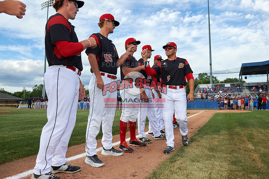 Batavia Muckdogs Alex Fernandez (5) fist bumps teammates Jordan Hillyer (47), Justin Langley (55) and Ryley MacEachern (40) during introductions before a game against the State College Spikes on June 22, 2016 at Dwyer Stadium in Batavia, New York.  State College defeated Batavia 11-1.  (Mike Janes/Four Seam Images)