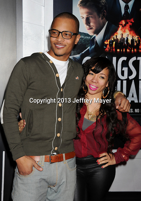 HOLLYWOOD, CA - JANUARY 07: T.I. and Tiny arrive at the 'Gangster Squad' - Los Angeles Premiere at Grauman's Chinese Theatre on January 7, 2013 in Hollywood, California.
