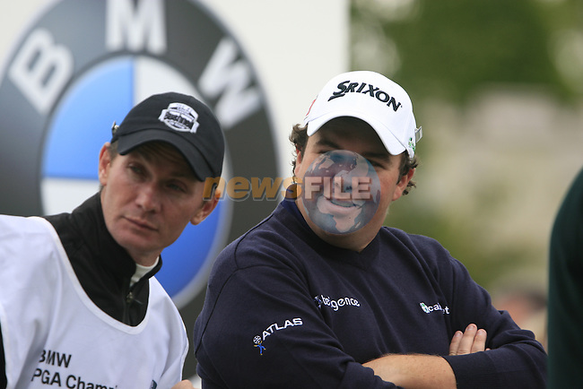 Shane Lowry (IRL) and caddy wait to tee off on the 1st tee to start his round on Day 2 of the BMW PGA Championship Championship at, Wentworth Club, Surrey, England, 27th May 2011. (Photo Eoin Clarke/Golffile 2011)