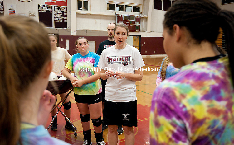 TORRINGTON,  CT-111716JS04-  Torrington volleyball head coach Christine Gamari talks with her players following practice Thursday at the school. Torrington will play Seymour in the Class M Finals on Saturday. <br /> Jim Shannon Republican American
