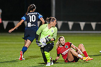 Kansas City, Mo. - Saturday April 23, 2016: FC Kansas City goalkeeper Nicole Barnhart (18) saves a shot on goal by Portland Thorns FC midfielder Allie Long (10) at Swope Soccer Village. The match ended in a 1-1 draw.