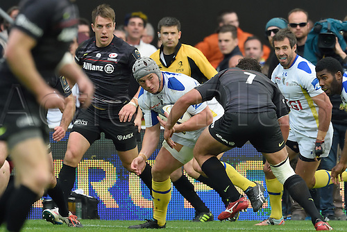 18.04.2015. Clermont-Ferrand, Auvergne, France. Champions Cup rugby semi-final between ASM Clermont and Saracens.   Jonathan Davies (asm) held by Jacques Burger (saracens)