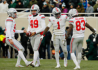 Ohio State Buckeyes punter Drue Chrisman (91), long snapper Liam McCullough (49), Ohio State Buckeyes wide receiver Johnnie Dixon III (1) and wide receiver Terry McLaurin (83) celebrate downing a punt inside the 5-yard line during the fourth quarter of the NCAA football game against the Michigan State Spartans at Spartan Stadium in East Lansing, Mich. on Nov. 10, 2018. Ohio State won 26-6. [Adam Cairns/Dispatch]