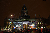 PICTURE BY VAUGHN RIDLEY/SWPIX.COM - Cycling - Tour de France - Yorkshire Grand Depart 2014 Launch - Town Hall, Leeds, England - 17/01/13 - The crowds prepares for the fireworks at Leeds Town Hall.