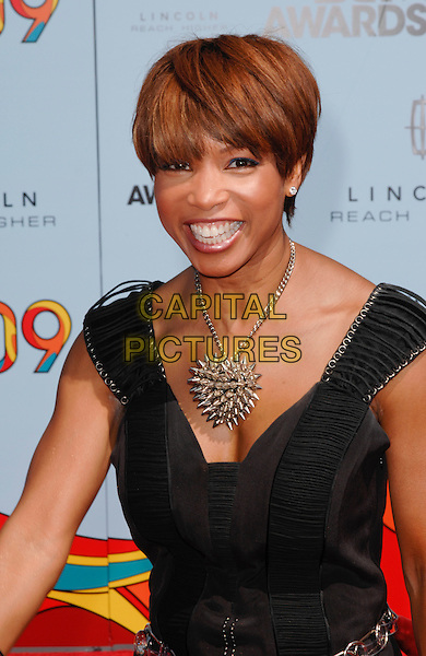 ELISE NEAL.2009 BET Awards - Arrivals held at the Shrine Auditorium, Los Angeles, CA, USA. .June 28th, 2009 .half length gold spikes necklace jewellery jewelry black dress .CAP/ROT.©Lee Roth/Roth Stock/Capital Pictures