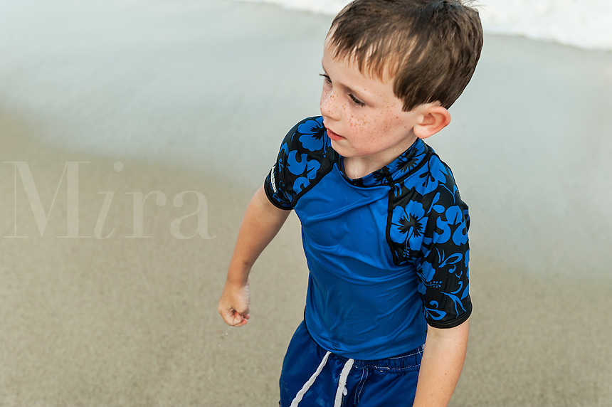 Boy shivering cold after swimming in the ocean, Cape Cod, Massachusetts, USA