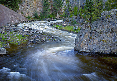 THE FIREHOLE RIVER WEAVES ITS WAY THROUGH THE CANYON IN LONG EXPOSURE IN YELLOWSTONE NATIONAL PARK,WYOMING