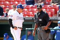 Home plate umpire A.J. Johnson explains a call to manager Wally Backman #8 during a game between the Buffalo Bisons and Lehigh Valley IronPigs at Coca-Cola Field on April 19, 2012 in Buffalo, New York.  Lehigh Valley defeated Buffalo 8-4.  (Mike Janes/Four Seam Images)